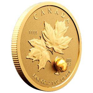 Reverso de la moneda de una onza de oro dedicada al 125 Aniversario de la Fiebre del Oro del Klondike
